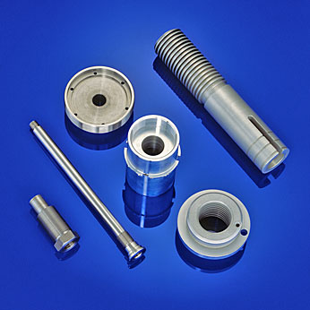 Turned parts made from different materials and with surface treatment by Rühle Maschinenbau parts manufacturing